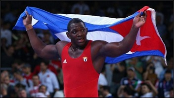 mijain-lopez-nunez-of-cuba-celebrates-beating-heiki-nabi-of-estonia-in-their-mens-greco-roman-120-kg-wrestling-gold-medal-580x326