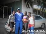 Yirisleidis Ford, Ayamey Medina, Yaritza Martínez junto al preparador Eladio Hernández_Lanzamiento del martillo