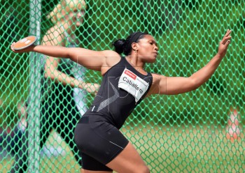 epa05321690 Cuba's Denia Caballero competes in the women's Discus Throw event at the athletics meeting in Halle Saale, Germany, 21 May 2016.  EPA/HENDRIK SCHMIDT