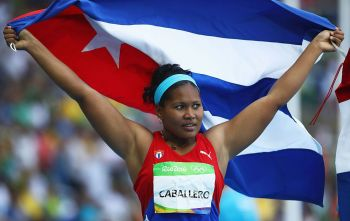 RIO DE JANEIRO, BRAZIL - AUGUST 16:  Bronze medalist Denia Caballero of Cuba reacts after the Women's Discus Throw Final on Day 11 of the Rio 2016 Olympic Games at the Olympic Stadium on August 16, 2016 in Rio de Janeiro, Brazil.  (Photo by Cameron Spencer/Getty Images)