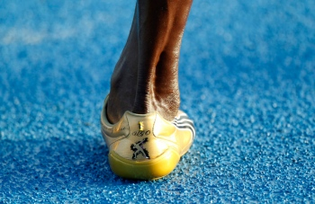 Usain Bolt of Jamaica's leg is seen as he runs during a training session near the Athlete's village at the IAAF World Championships in Daegu August 31, 2011. REUTERS/Max Rossi   (SOUTH KOREA   Tags: SPORT ATHLETICS) ATHLETICS WORLD/