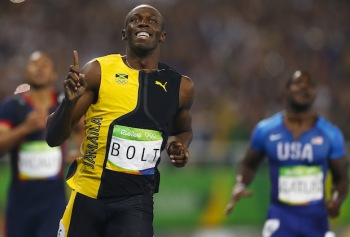 Mandatory Credit: Photo by Fernando Soutello/AGIF/REX/Shutterstock (5828738h) Bolt Usain of Jamaica (R), gold medal, during men's finals of 100m at athletics competitions of the 2016 Rio 2016 Olympic Games at the Olympic stadium in Rio de Janeiro, Brazil, Sunday, Aug. 14, 2016 Rio 2016 Olympic Games, Athletics, Men's Finals 100m, Olympic Stadium, Brazil - 14 Aug 2016