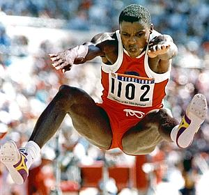 (FILE) Picture taken 26 September 1988 of US athlete Carl Lewis during the men's long jump final at the Olympic Stadium in Seoul during the Olympic Games. (FILM) AFP PHOTO